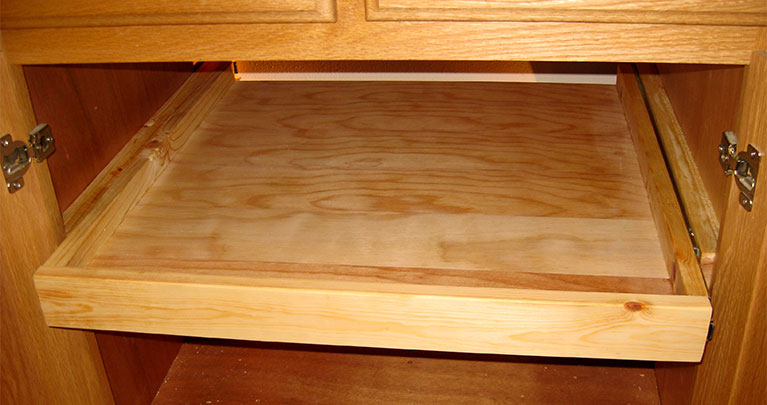 Roll-out shelves are a popular kitchen cabinet accessory.