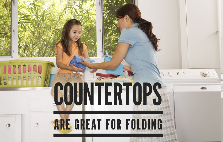 Countertops add to the appeal of laundry room cabinets.