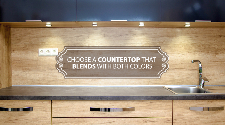 With two tone cabinets, choose a countertop that blends with both colors.