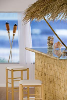 Making a tiki bar one of the creative ideas for cabinets in the home.