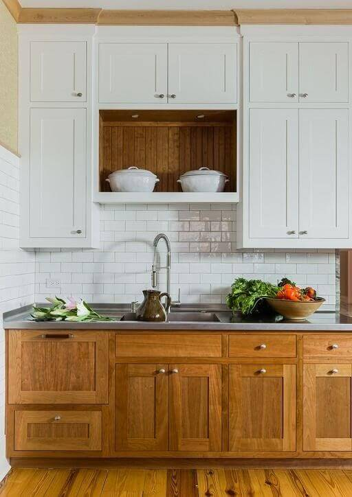 Contrasting cabinets in wood grain and white
