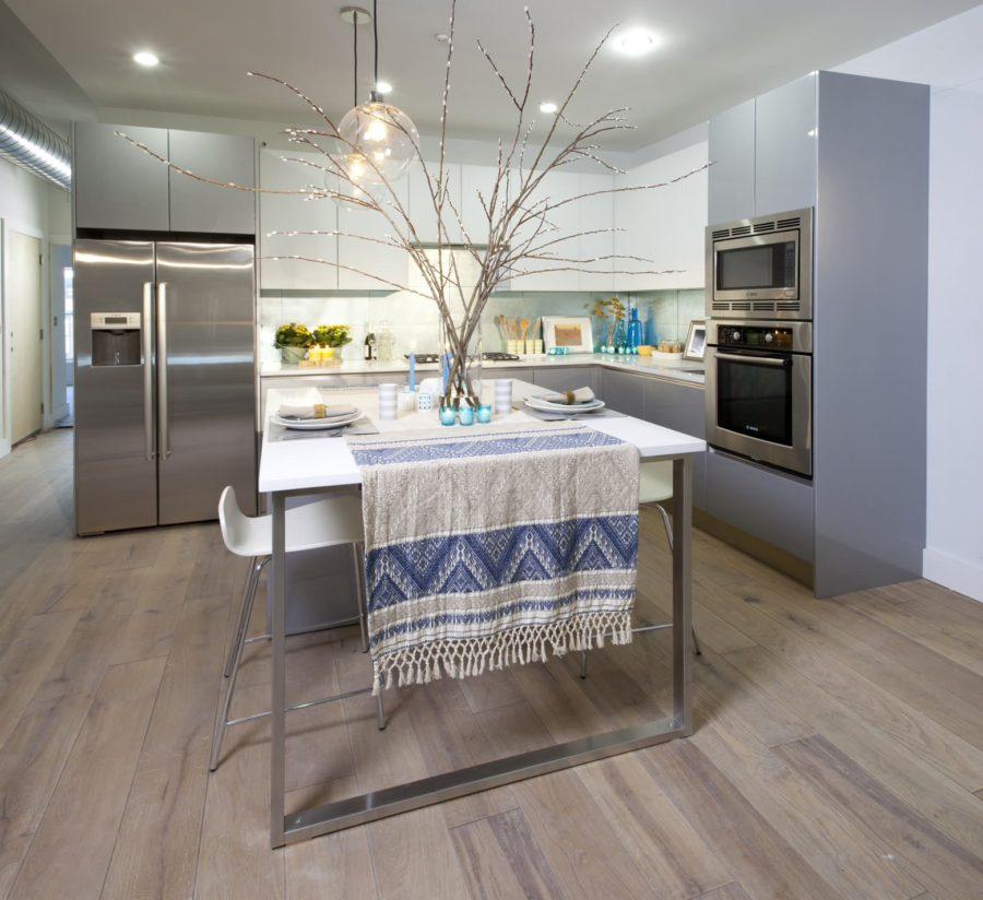 Frameless white upper cabinets paired with frameless light gray base cabinets