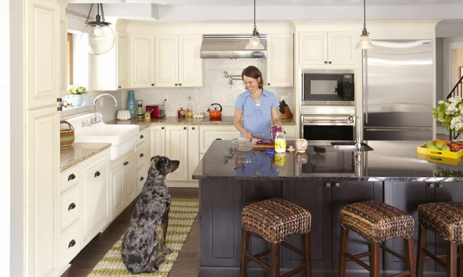 Charcoal gray Shaker-style kitchen cabinets with a white Shaker island