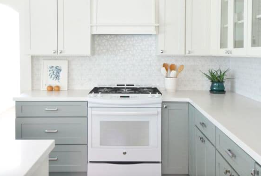 White Shaker-style kitchen cabinets with light gray base cabinets