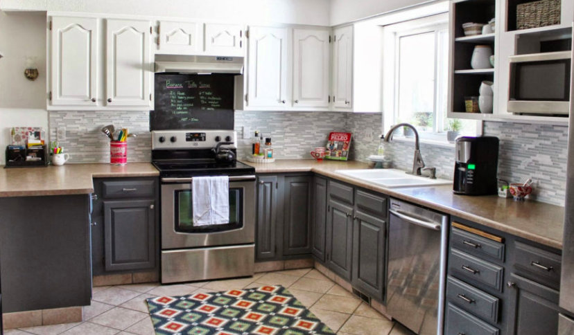 White Shaker-style kitchen cabinets with charcoal base cabinets