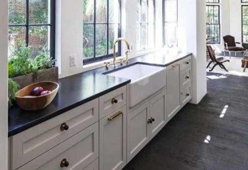 galley kitchen features bronze hardware and white cabinets