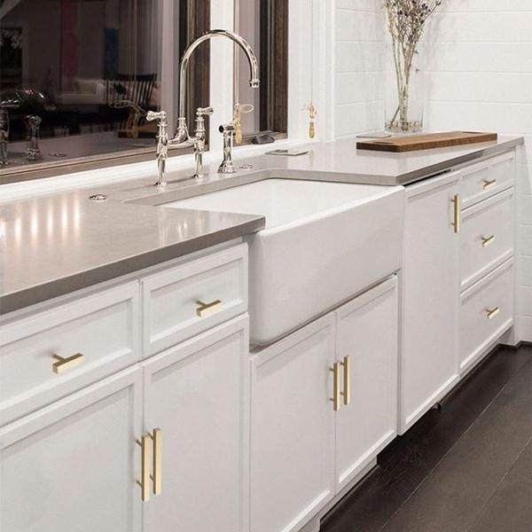 brushed gold hardware with white kitchen cabinets