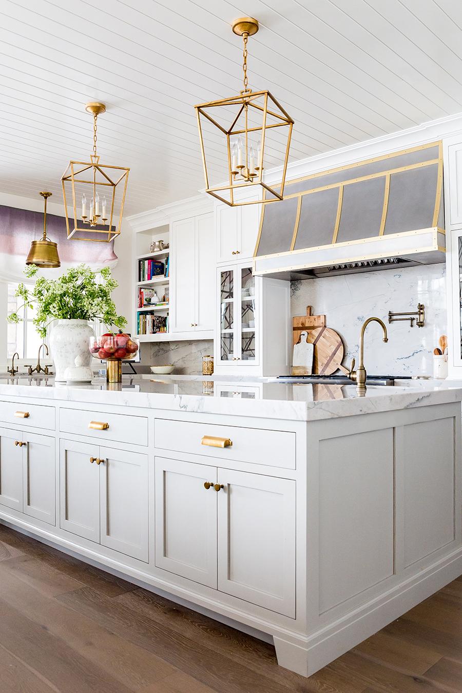 Matte gold hardware in white kitchen