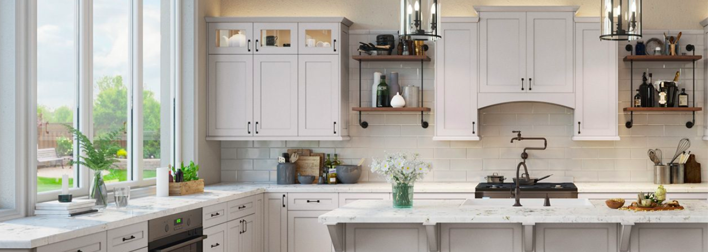 White kitchen cabinets with black handles